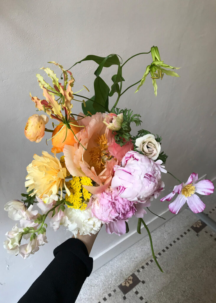 bespoke summer wedding bouquet by wilder with peonies and a paper cosmos