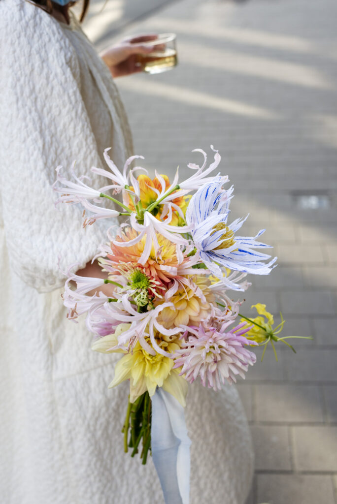 wedding bouquet with seasonal flowers and a paper flower made by Wilder Antwerp