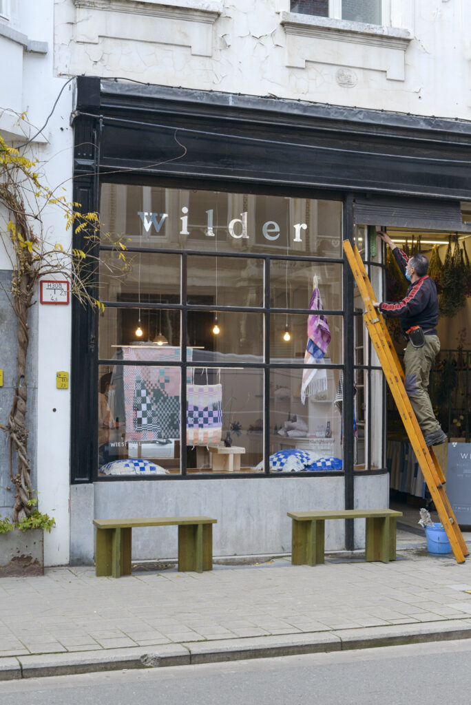 Wiesi Will weavings on display in the window of Wilder Antwerp flower shop