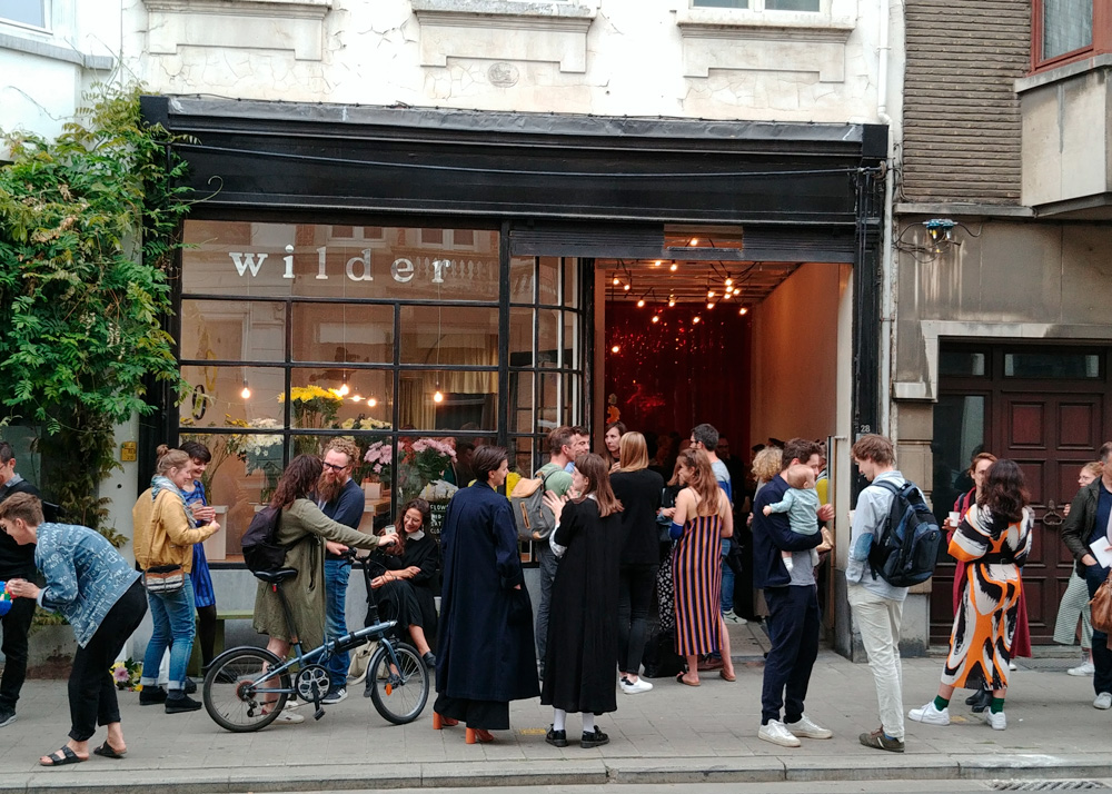 People gathering for the opening of Wilder Antwerp flower shop at Provinciestraat 28, Borgerhout