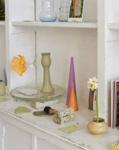 Shelves with vintage finds, stationery and candles at Wilder Antwerp