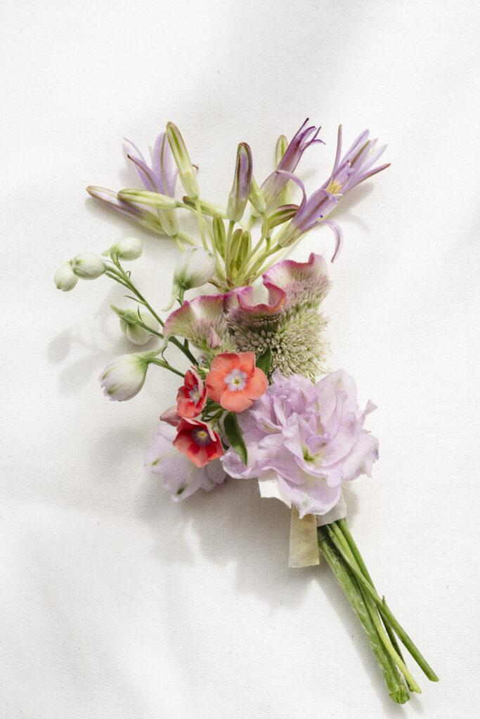 Colourful wedding corsage made by Wilder Antwerp